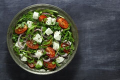 Salad with arugula, tomato and cheese Royalty Free Stock Photo