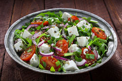 Salad with arugula, tomato and cheese Royalty Free Stock Images
