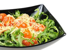 Salad with arugula and tomatoes Stock Images