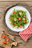 Salad with arugula, tomatoes cherry, mozzarella, pine nuts and b Stock Photos
