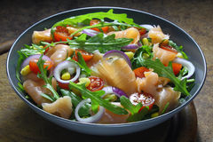Salad with arugula, tomatoes, corn and smoked salmon Royalty Free Stock Images