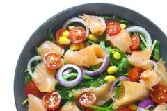Salad with arugula, tomatoes, corn and smoked salmon Stock Image