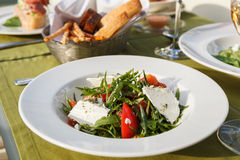 Salad. With arugula, tomatoes and feta cheese Royalty Free Stock Photo