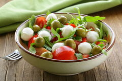 Salad with arugula, tomatoes and mozzarella Stock Image