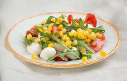 Salad from arugula tomatoes mozzarella and corn Stock Photography