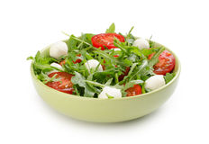 Salad from arugula tomatoes and mozzarella Stock Photos