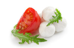 Salad from arugula tomatoes and mozzarella Royalty Free Stock Images