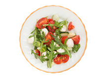 Salad from arugula tomatoes and mozzarella Stock Photo