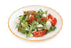 Salad from arugula tomatoes and mozzarella Royalty Free Stock Photo