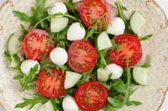 Salad from arugula tomatoes and mozzarella Stock Images