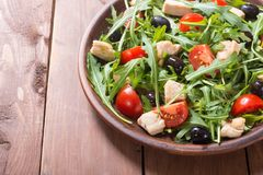 Salad with arugula. Tomatoes , olives and chicken royalty free stock photography