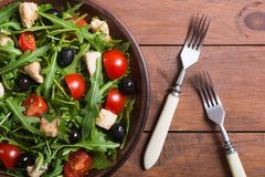 Salad with arugula. Tomatoes , olives and chicken royalty free stock photos