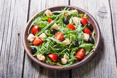 Salad with arugula. Tomatoes , olives and chicken royalty free stock image