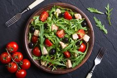 Salad with arugula. Tomatoes , olives and chicken royalty free stock images