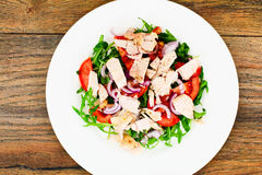 Salad with Arugula, Tomatoes, Turkey Breast, Grape Seed Oil, Soy Royalty Free Stock Photography