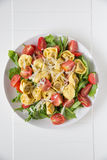 Salad with arugula, tomatos and tortellini Royalty Free Stock Image