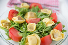 Salad with arugula, tomatos and tortellini Stock Images