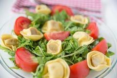 Salad with arugula, tomatos and tortellini Stock Images
