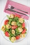 Salad with arugula, tomatos and tortellini Stock Image