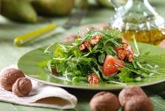 Salad of arugula and walnuts Stock Photography