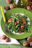 Salad of arugula and walnuts Royalty Free Stock Image