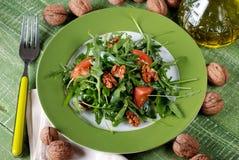 Salad of arugula and walnuts Stock Photos