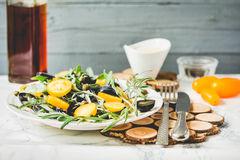Salad with arugula, yellow tomatoes, olives, grapes and sesame,. Fresh green salad with arugula, yellow tomatoes, olives, grapes and sesame,healthy lifestyle and Royalty Free Stock Photography