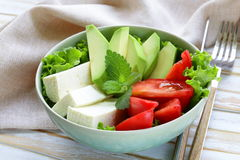 Salad in asian style with tofu cheese, avocado Stock Photos