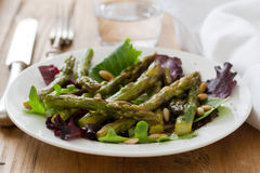 Salad asparagus and pine nuts Stock Image