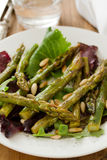 Salad asparagus and pine nuts in white plate Royalty Free Stock Image
