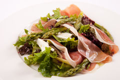 Salad with asparagus and prosciutto. Green Salad with asparagus and prosciutto Stock Photography