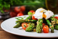Salad of asparagus, tomatoes and egg Royalty Free Stock Image