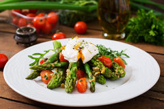 Salad of asparagus, tomatoes and  egg Stock Images