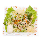 Salad with assorted greens, fried pork, carrots Stock Photos