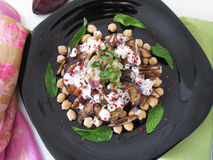 Salad with aubergines, dates and chick peas. Royalty Free Stock Photography