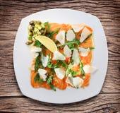 Salad with avacado, salmon, arugula and parmesan cheese. Royalty Free Stock Photo