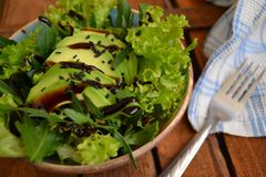 Salad with avocado and arugula stock images