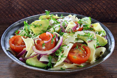 Salad with avocado, cheese and tomato Stock Image