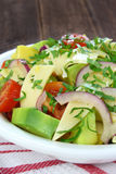Salad with avocado, cheese and tomato Royalty Free Stock Photography