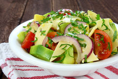 Salad with avocado, cheese and tomato Royalty Free Stock Photo