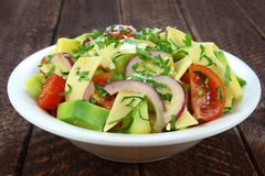 Salad with avocado, cheese and tomato Stock Photo