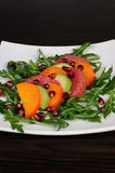 Salad with avocado, grapefruit, persimmon Stock Photo