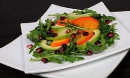Salad with avocado, grapefruit, persimmon Stock Photography