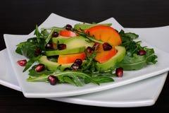 Salad with avocado, grapefruit, persimmon Stock Image