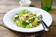 Salad with avocado, lettuce, orange and crushed nuts Stock Photo
