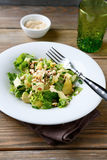 Salad with Avocado, Lettuce, Orange and Nuts on a bowl Royalty Free Stock Photos