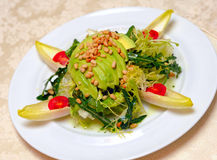 Salad from avocado, pine nuts and tomatoes stock photos