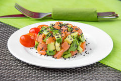 Salad with avocado and red fish. On white plate Royalty Free Stock Photography