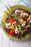 Salad with avocado, shrimp and vegetables close-up. vertical top view Royalty Free Stock Image