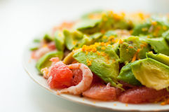 Salad with avocado and shrimps. Salad with avocado, shrimps and grapefruit Royalty Free Stock Photos